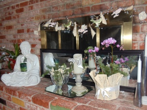 My fireplace-- a mirror along the glass doors prevents a draft plus reflects more candlelight!
