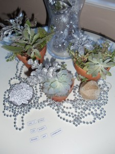 Sparkle up the succulents with silver leaves, ornaments and beads.  Magnetic words make it a fun place to sit!
